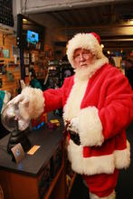 Santa Claus choosing a science themed lamp for you!