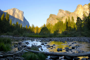 Sunrise in Yosemite Valley looking onto El Capitan and Cathedral Rocks.  Courtesy of MacGillivray Freeman Films. Photographer: Barbara MacGillivray
