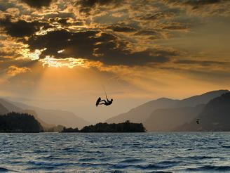 A kiteboarder soars above the Columbia River Gorge in Oregon.