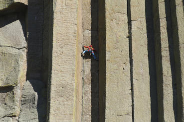 Conrad Anker scales the columns of Devils Tower National Monument in Wyoming. Courtesy of MacGillivray Freeman Films. Photographer: Barbara MacGillivray