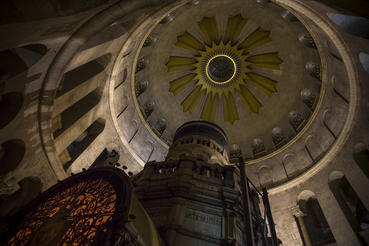The Edicule containing the traditional tomb of Jesus sits beneath a large domed rotunda in the Church of the Holy Sepulchre.