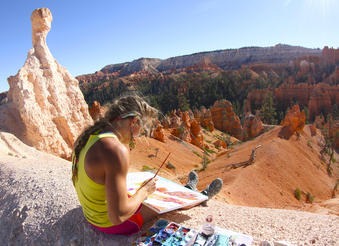Rachel Pohl paints the landscapes of Bryce Canyon in Utah.  Courtesy of MacGillivray Freeman Films. Photographer: Barbara MacGillivray