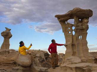 Ariel and John admire the other-worldly sandstone hoodoos in New Mexico's Ah-Shi-Sle-Pah Wilderness.