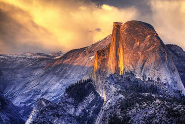 Half Dome rises 4,737 feet above the Merced River on the floor of Yosemite Valley in California.  Copyright Dimitri Fomin