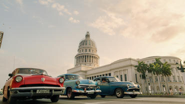 Cars in front of El Capitolio, or National Capitol Building, in Havana.
