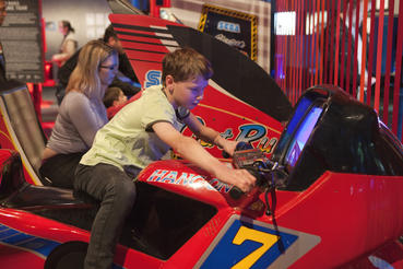 Hang-On and Outrun are two classic Sega arcade machines in the Game Changers section of Game Masters. Photo courtesy of ACMI (Australian Centre for the Moving Image).