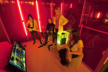 Gather your friends together to compete at Rock Band 3 in a private music booth in the Game Changers section of Game Masters. Photo courtesy of ACMI (Australian Centre for the Moving Image).