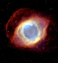 Composite image of the colorful Helix Nebula taken with the Hubble Space Telescope's Advanced Camera for Surveys and the Mosaic II Camera on the 4-meter telescope at Cerro Tololo Inter-American Observatory in Chile.