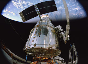 Astronauts replace a Fine Guidance Sensor in the mission's fifth and final session of extravehicular activity (EVA).