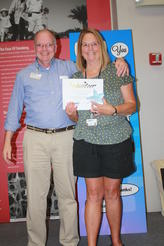 Membership's Mike Conley & Adult Volunteer of the Year Janine Heim