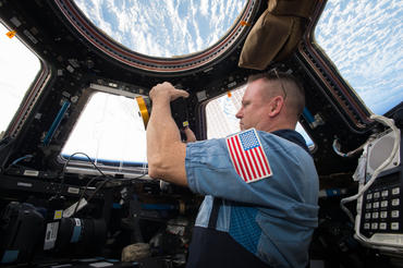 IMAX® film A Beautiful Planet – Onboard the International Space Station (ISS) – NASA Commander Barry (Butch) Wilmore shoots a scene with the IMAX® camera through the window of the International Space Station's Cupola Observation Module. © 2016 IMAX Corporation Photo courtesy NASA From IMAX Entertainment and director Toni Myers and narrated by Jennifer Lawrence, A Beautiful Planet is a stunning glimpse of Earth from space, bringing a heightened awareness of our planet—and the effects of humanity over time—as