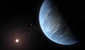 Artist's impression shows the planet K2-18b. Image Credit: ESA/Hubble, M. Kornmesser